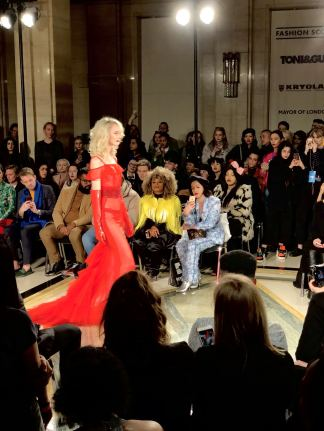 Malan Breton FW18 Fashion Scout London Fashion Week a model on the runway wearing red organza with gloves