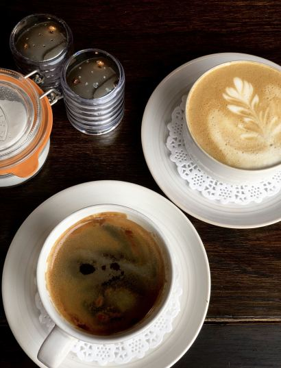 A latte & an Americano on the table at Forsyth & Reed in white china