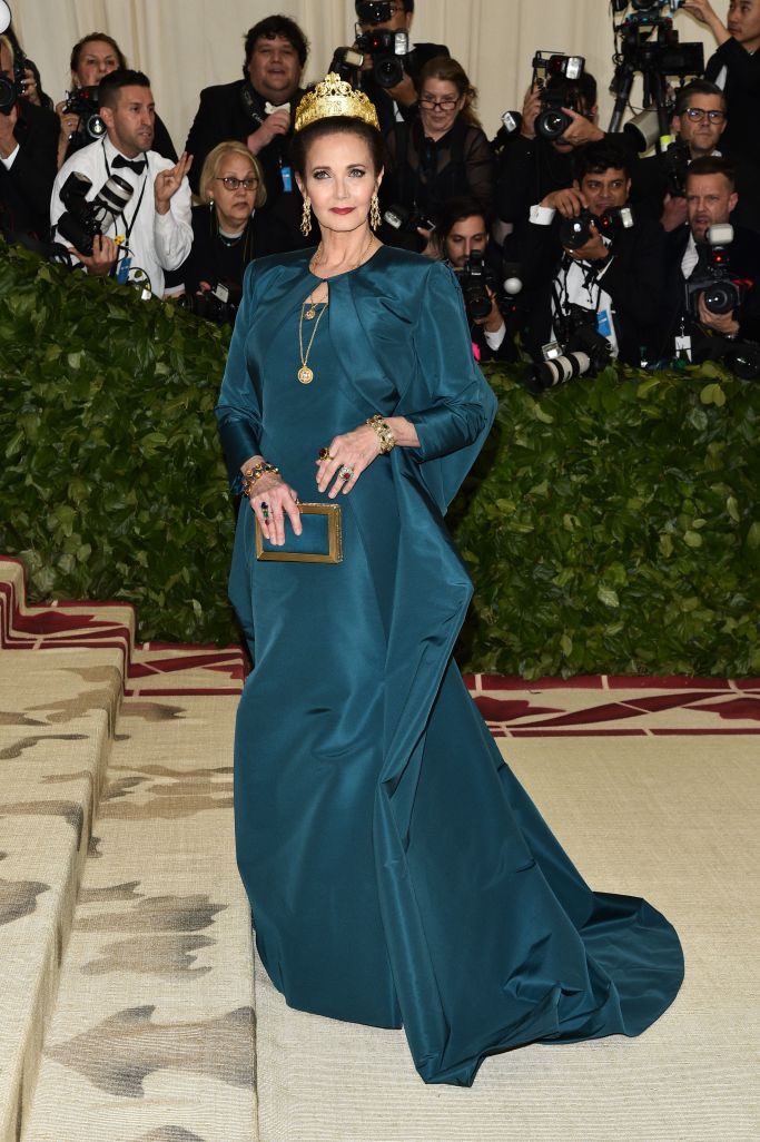 Frontview of lynda Carter wearing a teal gown on the Met Gala red carpet 2018