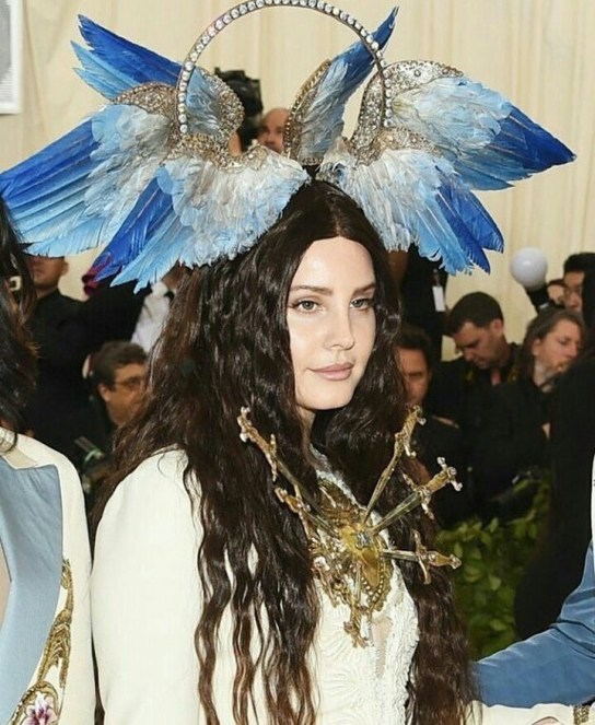 A close up of Lana Del Rey on the red carpet at the 2018 met gala wearing head to toe gucci