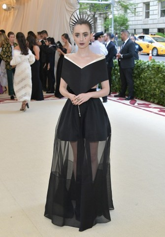 Full length image of Lily Collings at the 2018 Met Gala