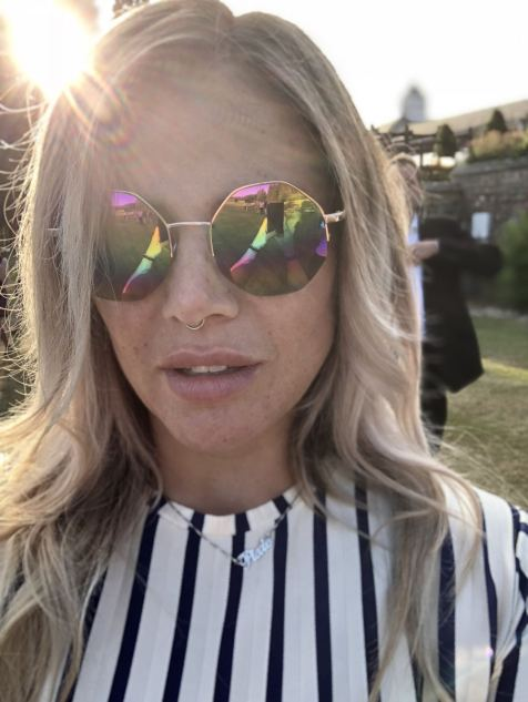 Blogger Pixie Tenenbaum wearing hexagonal mirrored sunglasses and a striped Zara dress at the Slaley Hall Summer soiree in Northumberland in July 2018