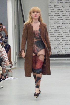A model on the runway for Jayne Pierson SS19 at London Fashion Week Conde Naste College of Fashion and Design wearing hand painted co-ord lingerie including longline bra, high waisted panties and stockings with a long line coat. (fashion voyeur blog)