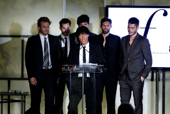 NEW YORK, NY - SEPTEMBER 10: Stephen Gan (C) appears on stage with models during The Daily Front Row's Third Annual Fashion Media Awards at the Park Hyatt New York on September 10, 2015 in New York City. (Photo by John Lamparski/Getty Images for The Daily Front Row)
