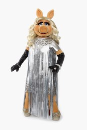 LONDON, ENGLAND - JANUARY 26: (EDITORS NOTE: This image has been retouched) Miss Piggy debuts her dress designed by Giles Deacon for the UK premiere of The Muppets this evening at The Mayfair Hotel on January 26, 2012 in London, England. The new muppets hits cinemas on February 10th. (Photo by Chris Jackson/Getty Images for Disney)