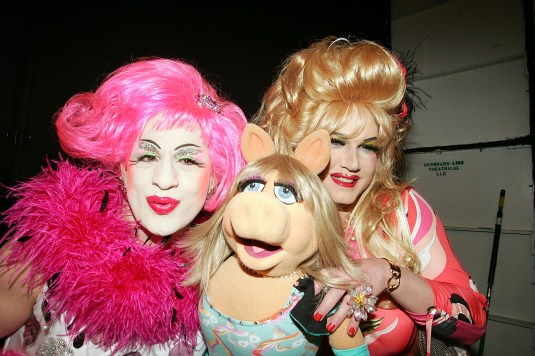 NEW YORK - FEBRUARY 04: Crossdressers Brandy Wine and Brenda A. Go-Go poses with Miss Piggy backstage at the Heatherette Fall 2005 show during the Olympus Fashion Week at Bryant Park February 4, 2005 in New York City. (Photo by Carlo Allegri/Getty Images)