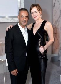 Women's Creative Director of Calvin Klein Collection Francisco Costa and Dakota Johnson