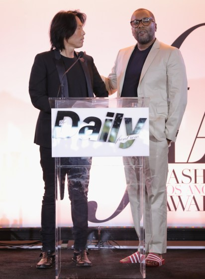 WEST HOLLYWOOD, CA - APRIL 02: Honoree Stephen Gan accepts the Visionary Award from director Lee Daniels during the Daily Front Row's 3rd Annual Fashion Los Angeles Awards at Sunset Tower Hotel on April 2, 2017 in West Hollywood, California. (Photo by Neilson Barnard/Getty Images)