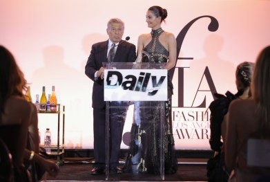 WEST HOLLYWOOD, CA - APRIL 02: Chief Marketing Officer of Creative Services of Limited Brands Edward Razek (L) and model Lily Aldridge speak onstage during the Daily Front Row's 3rd Annual Fashion Los Angeles Awards at Sunset Tower Hotel on April 2, 2017 in West Hollywood, California. (Photo by Neilson Barnard/Getty Images)