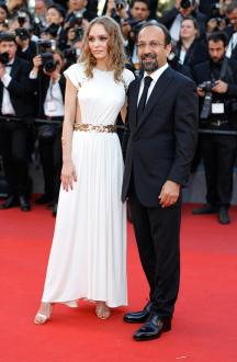 """CANNES, FRANCE - MAY 17: Director Asghar Farhadi and Lily-Rose Depp attend the """"Ismael's Ghosts (Les Fantomes d'Ismael)"""" screening and Opening Gala during the 70th annual Cannes Film Festival at Palais des Festivals on May 17, 2017 in Cannes, France. (Photo by Andreas Rentz/Getty Images)"""
