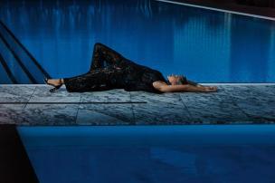 ELIE SAAB black sequin jumpsuit; STUART WEITZMAN Morepearls sandals; BULGARI Serpenti bracelet in 18-karat white gold with diamonds and emeralds