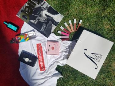 FLA gift bag sponsors: Maybelline NY, Moroccanoil, Daniel Wellington, Pretty Little Thing, Red Cherry Lashes, and LifeWTR (Hannah Turner-Harts)