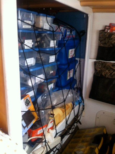 Cargo net holding in boxes of spares