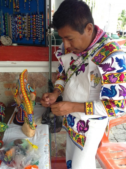 Notice the man's elaborately embroidered clothes.