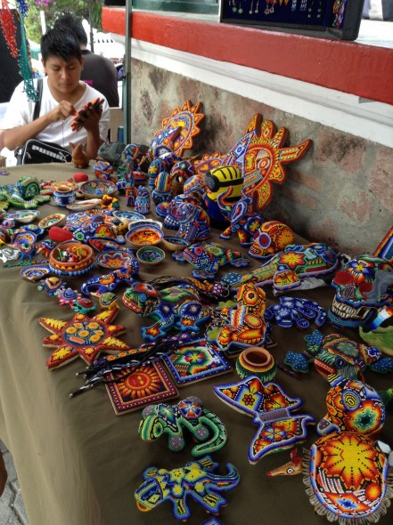 Table of beaded artwork for sale