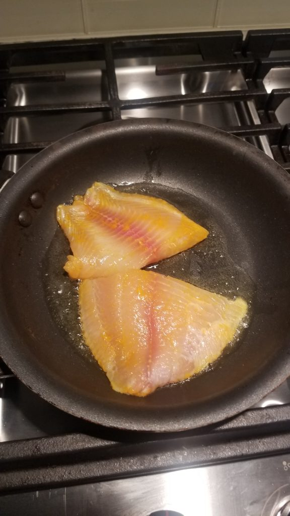 shallow fry fish on a pan