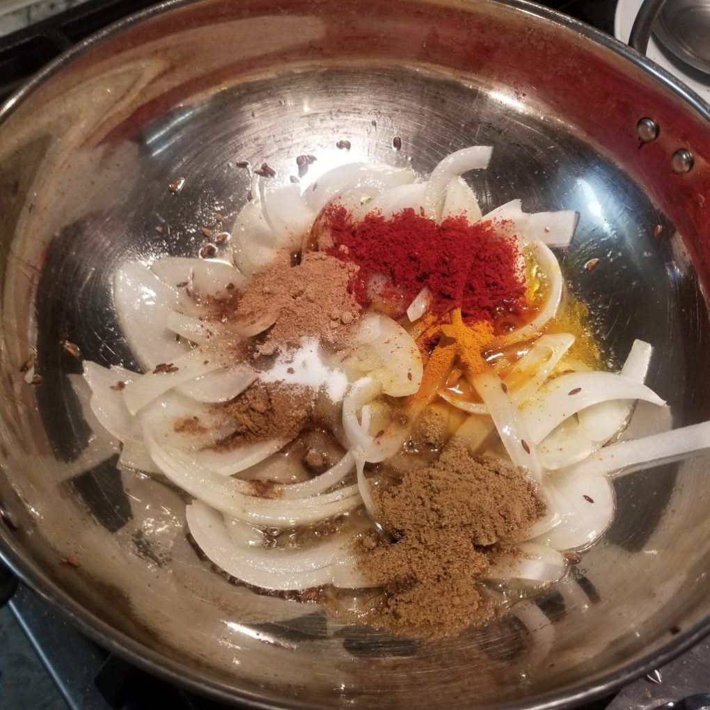 adding dry spices to the wok