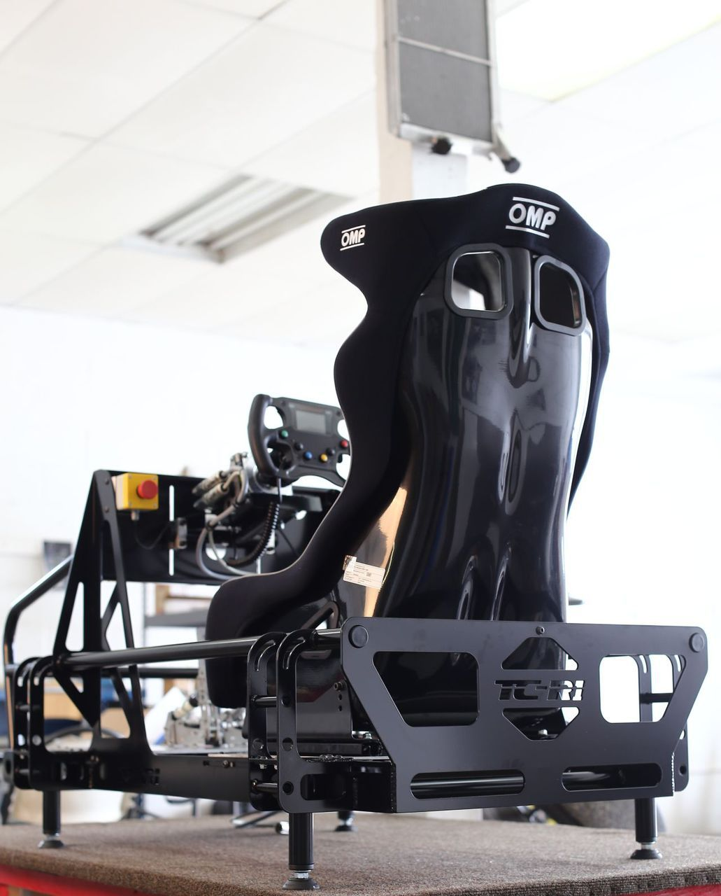hydraulic racing simulator chair yellow kitchen chairs fasttracksims pro sim products