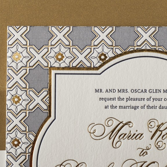 Close up detail of Amadore Antique by Bella Figura, vintage gold and navy wedding invitation, decorative frame and formal typesetting, gold shimmer metallic envelope liner