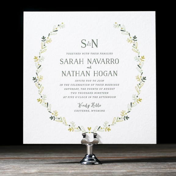 Chaplet by Bella Figura, whimsical illustrated floral wreath wedding invitation, green color palette, letterpress and digital printing, Hand drawn style fonts, monogram with ampersand