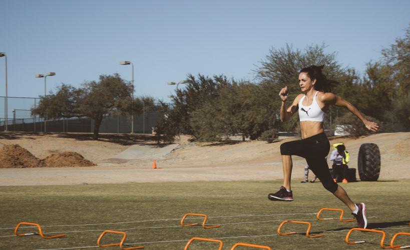 Runner going over mini hurdles