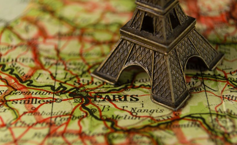 Eiffel Tower model on map of France