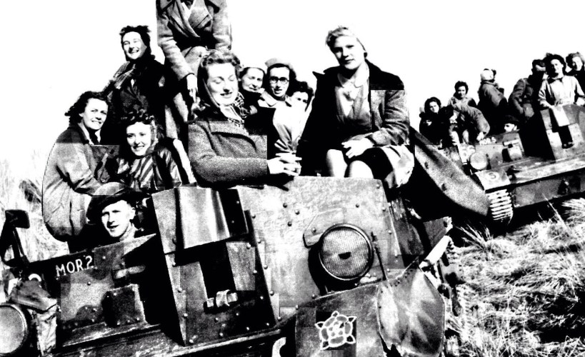 Grandma Nelly and colleagues sitting on a tank