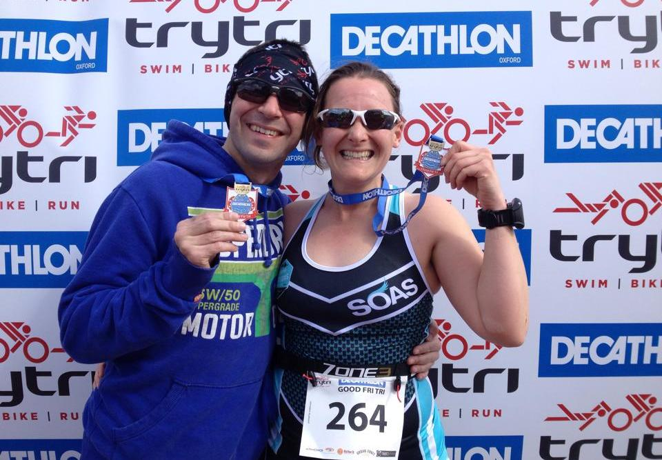 Tamsyn and Stuart with their medals after Good Fri Tri