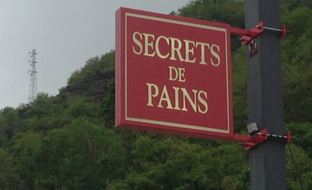 Sign saying 'Secrets de Pains'