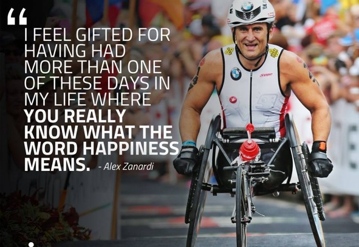 "Alex Zanardi at Ironman Kona 2014. A quote is written on top of the picture is the text ""I feel gifted for having had more than one of these days in my life where you really know what the word happiness means""."