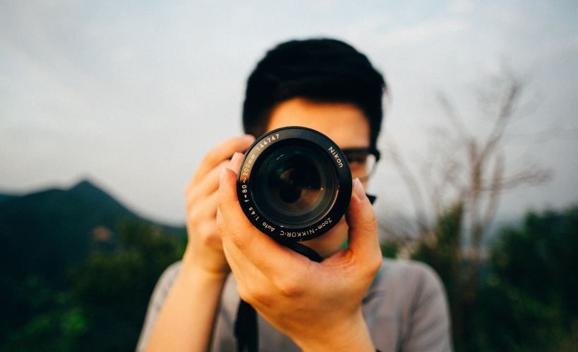 Close up of a photographer holding a camera