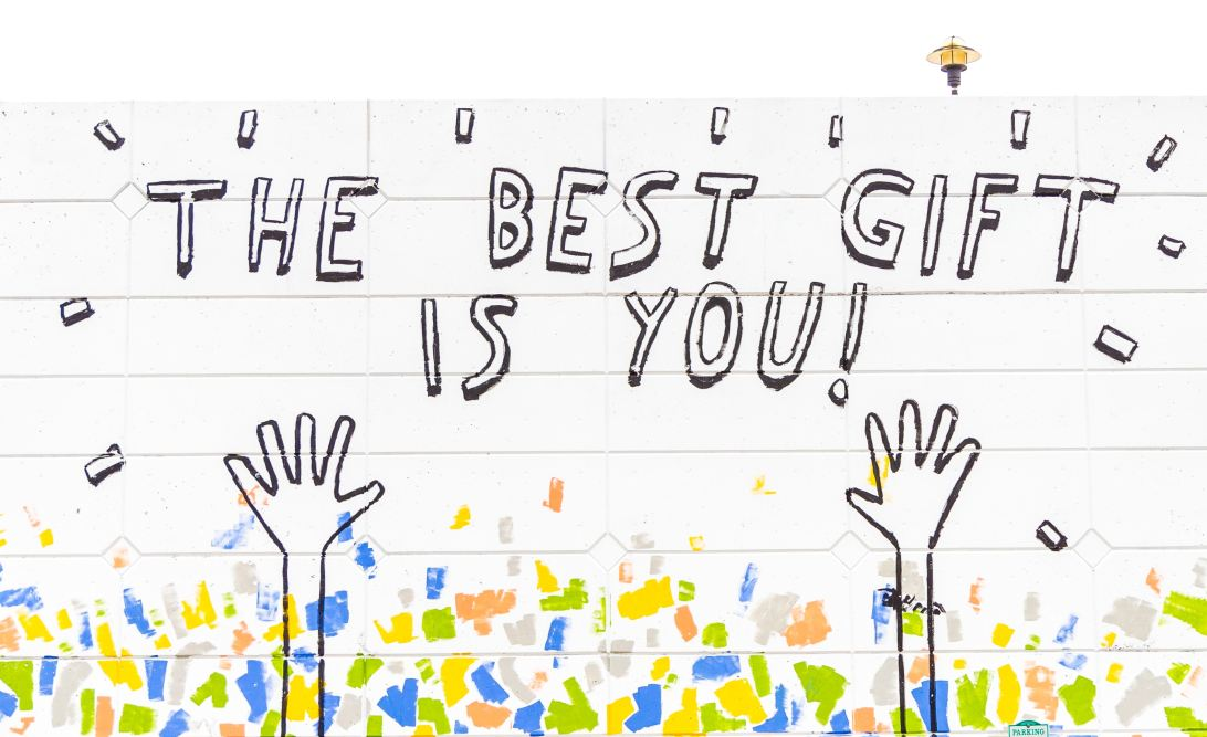 "Graffiti saying ""The best gift is you""."