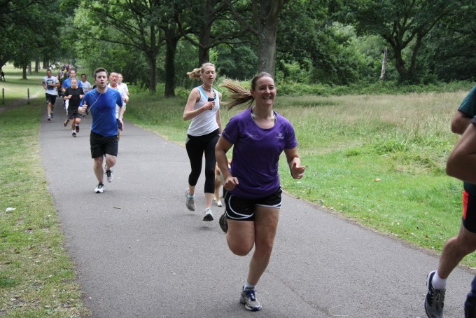 Tamsyn running with a huge smile at the third anniversary of Southampton parkrun.