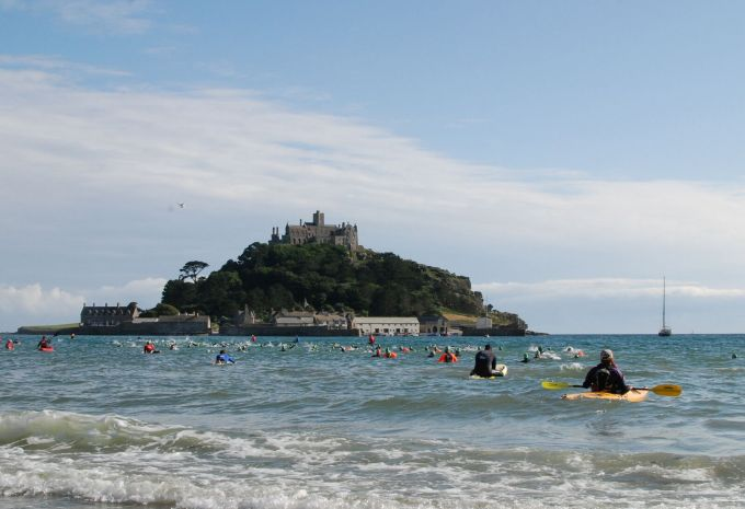 Kayakers and swimmers taking part in St. Michael's Mount swim.