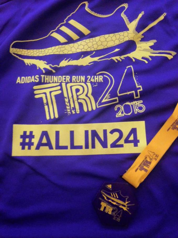 TR24 t-shirt with a medal across it.