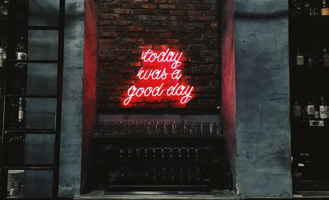 Neon sign saying 'today was a good day'.