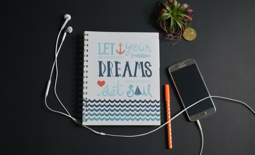 Book with the words 'Let your dreams set sail' on it