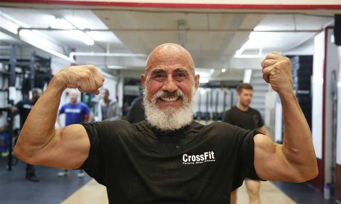 Jacinto Bonilla flexing his muscles