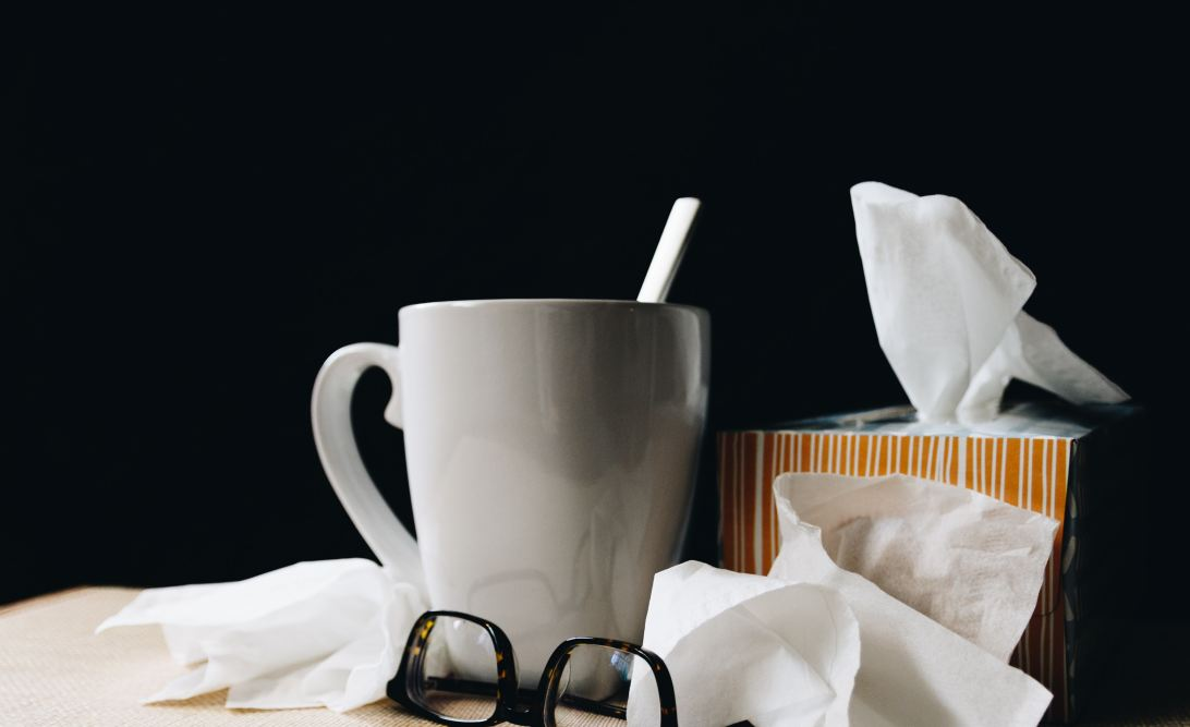 A hot drink and a box of tissues