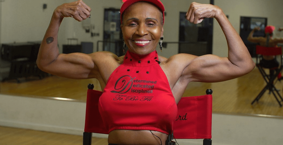 Ernestine Shepherd flexing her muscles at 81