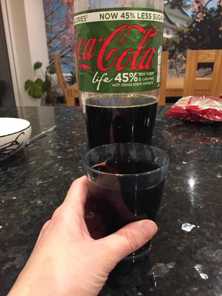A glass of Coca Cola Life