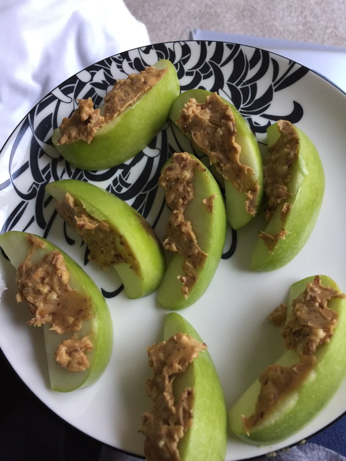 Slices of green apple with peanut butter