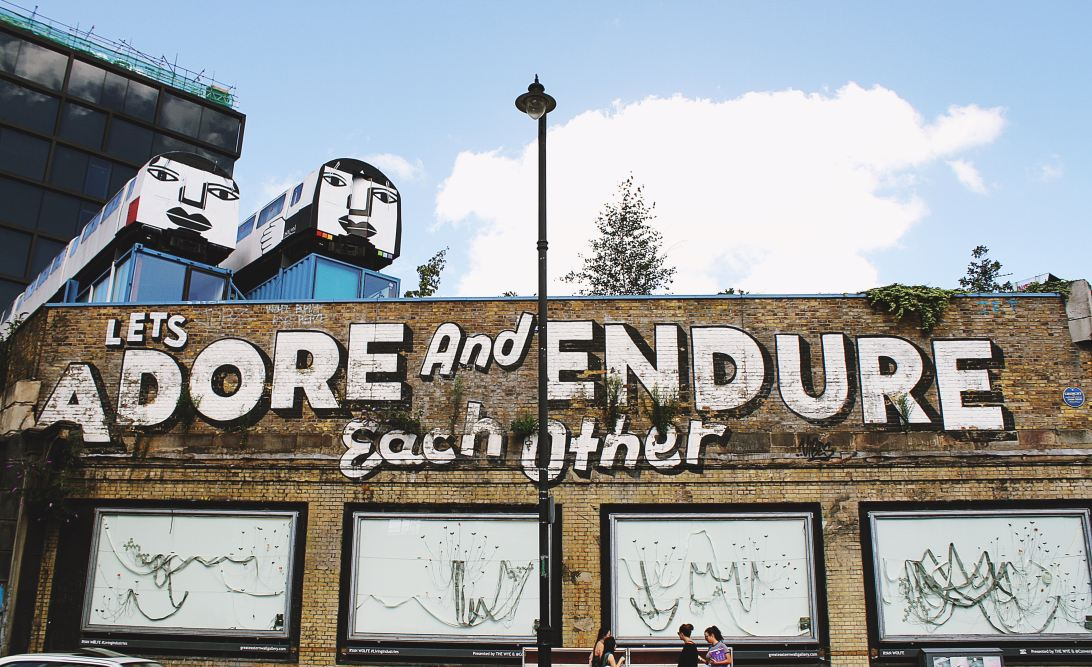 """A sign saying """"Adore and endure each other"""""""
