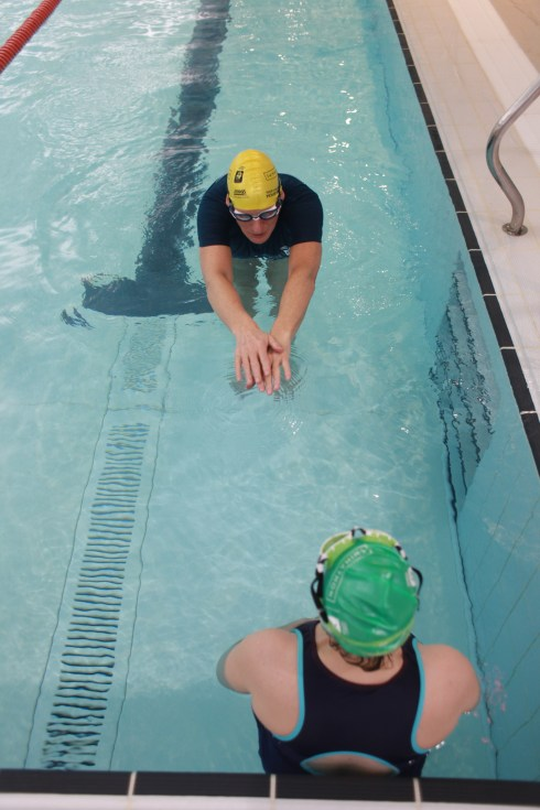Duncan Goodhew explaining catch up drill to Tamsyn
