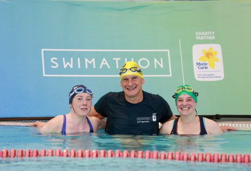 Adele, Duncan and Tamsyn by a Swimathon banner