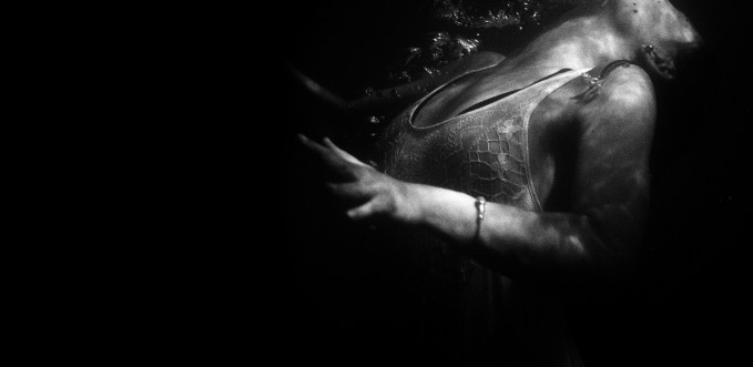 Black and white photo of someone drowning