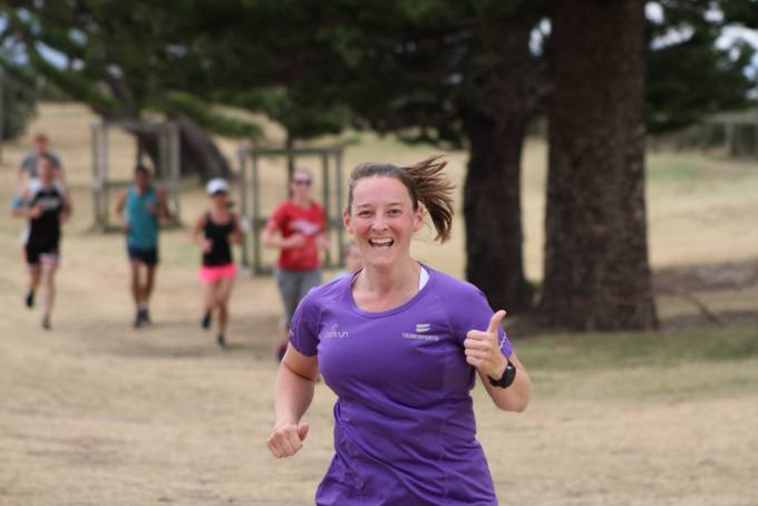 Tamsyn giving a thumbs up whilst running.