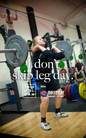 Woman lifting free weights with the slogan 'I don't skip leg day'