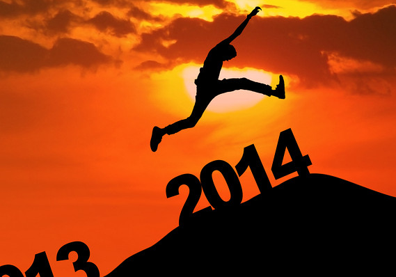 Silhouette of a person jumping over the word 2014