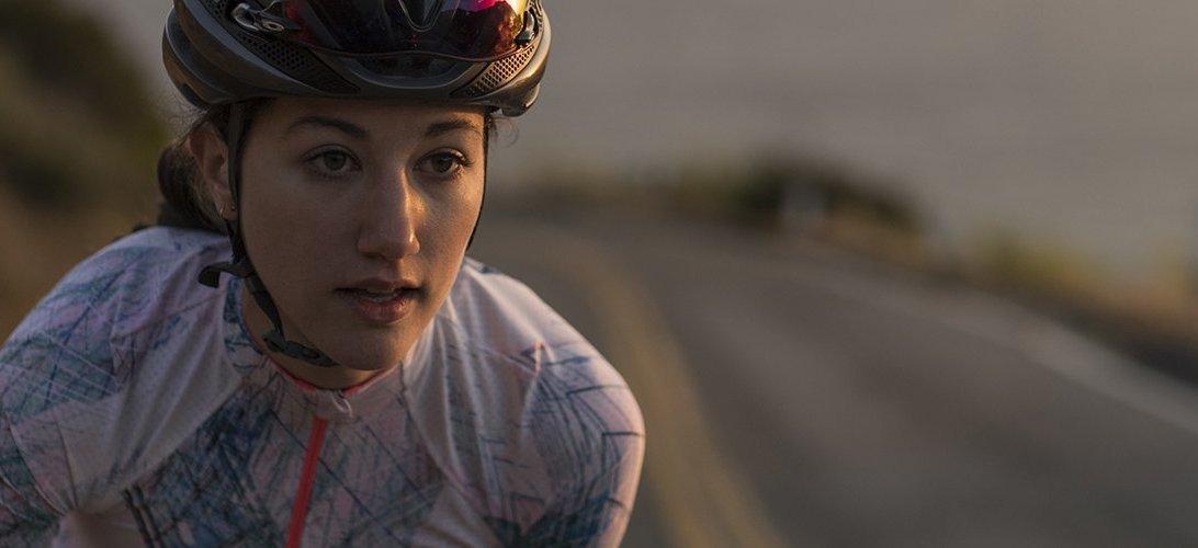 Close up of a woman riding a bike